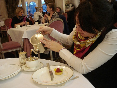 A student drinking tea in London.